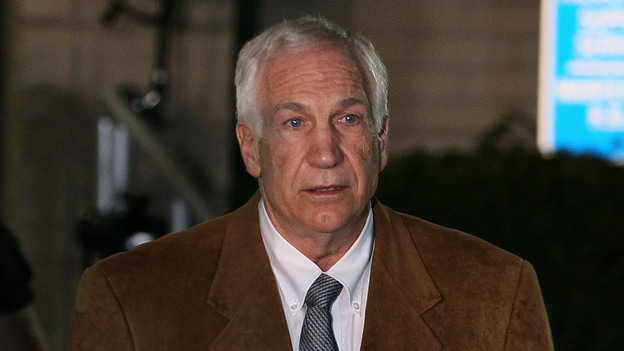 Former Penn State assistant football coach Jerry Sandusky being led away from court after his conviction last month. (Getty Images)