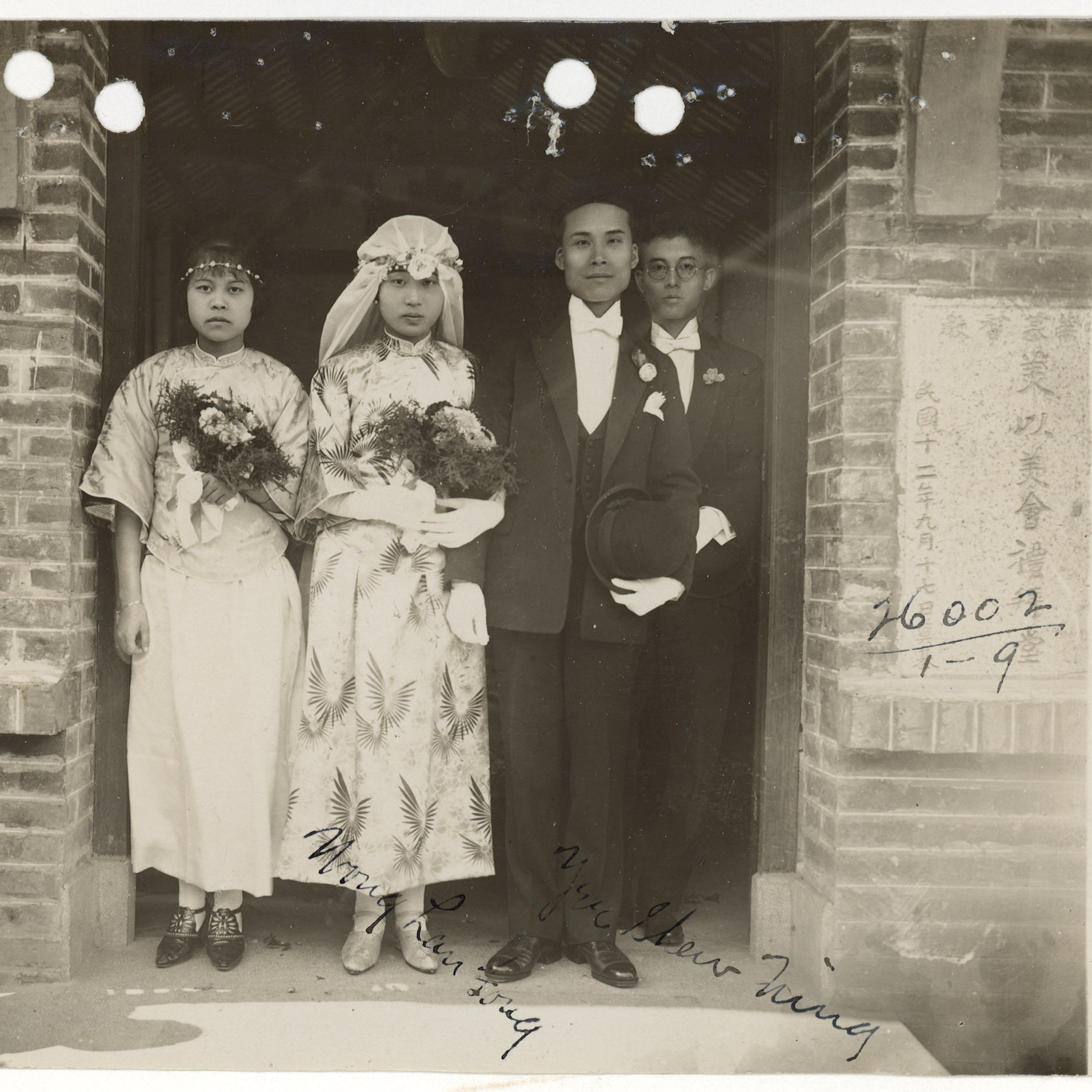 The wedding photograph of Wong Lan Fong and Yee Shew Ning, in front of the Mei Yi Mei Church, a Chinese Methodist Church, at the island of Honam, across the Pearl River from Canton (now Guangzhou) in 1926.