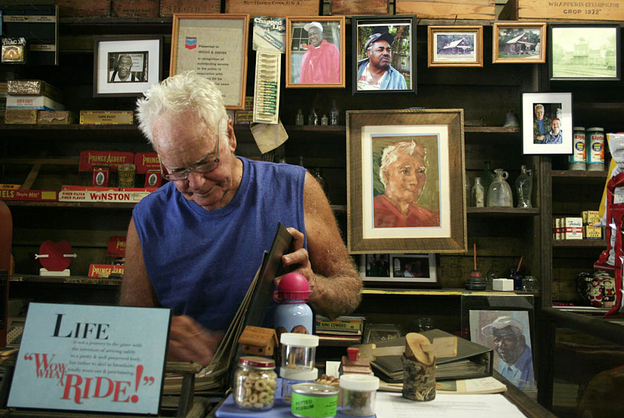 Freddie Wood stands at the counter of the Wood & Swink general store in Evinston, Fla. (StoryCorps)