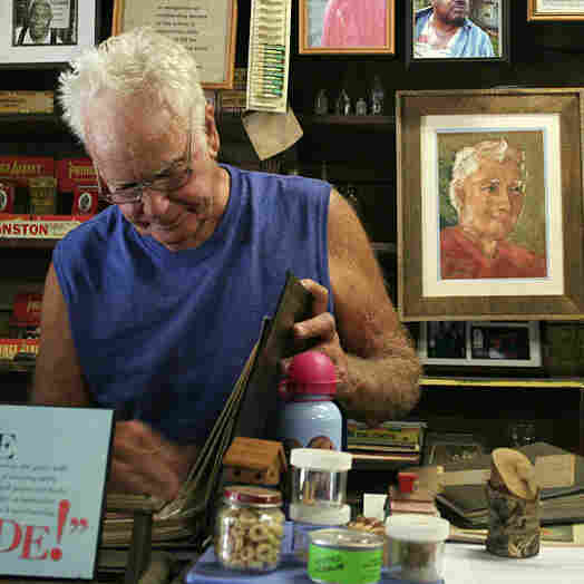 Freddie Wood stands at the counter of the Wood & Swink general store in Evinston, Fla. The store, founded in the late 1800s, houses the oldest post office in Florida.
