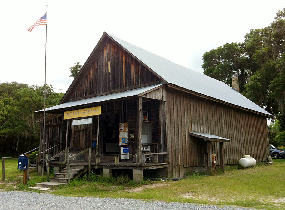 """The Wood & Swink general store sits near the crossroads of two county roads. Wilma Sue Wood, who was Evinston's postmaster for 32 years, says the town's 150 or so residents visit to hear news: """"Who's had a baby; who's died."""" (StoryCorps)"""