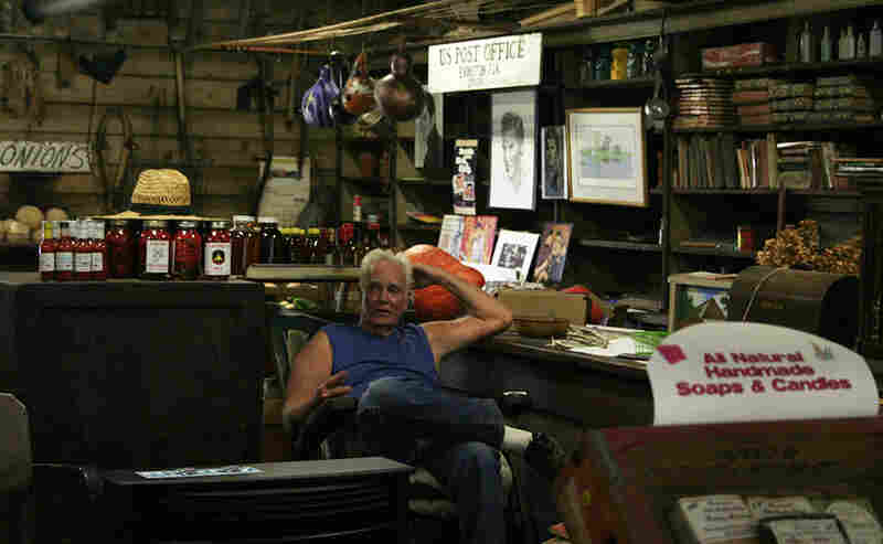 """""""The post office and the store, I just love it,"""" Wood says. He spends most of his afternoons sitting in a rocking chair in the middle of the store."""