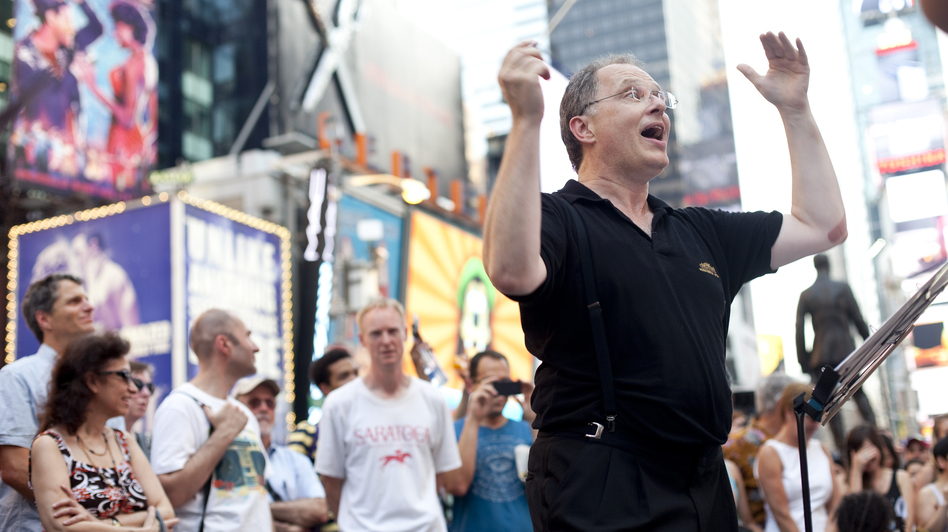 Conductor Kent Tritle in Times Square. (And that's WNYC's John Schaefer in the Saratoga T-shirt.) (Charles Ludeke for NPR)