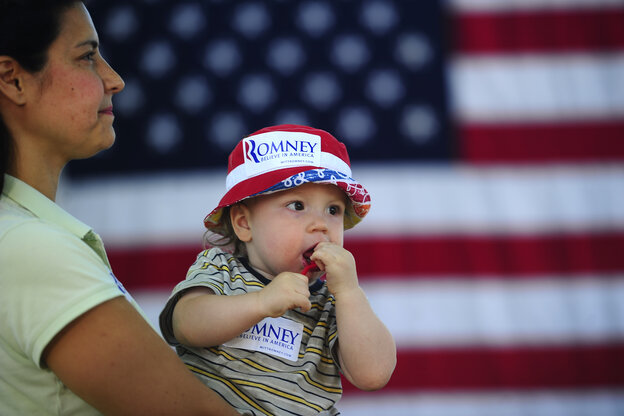 Mitt Romney supporters at a political rally in Milford, New Hampshire.