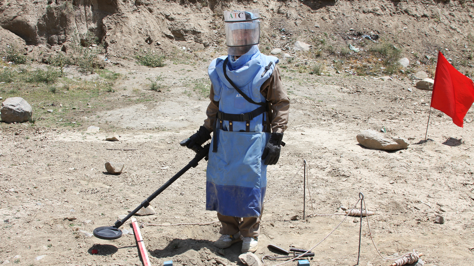 A de-mining expert demonstrates how to find land mines in a training area near Hakim Village in central Afghanistan, where Soviet mines dating to the 1980s are still a danger. (NPR)