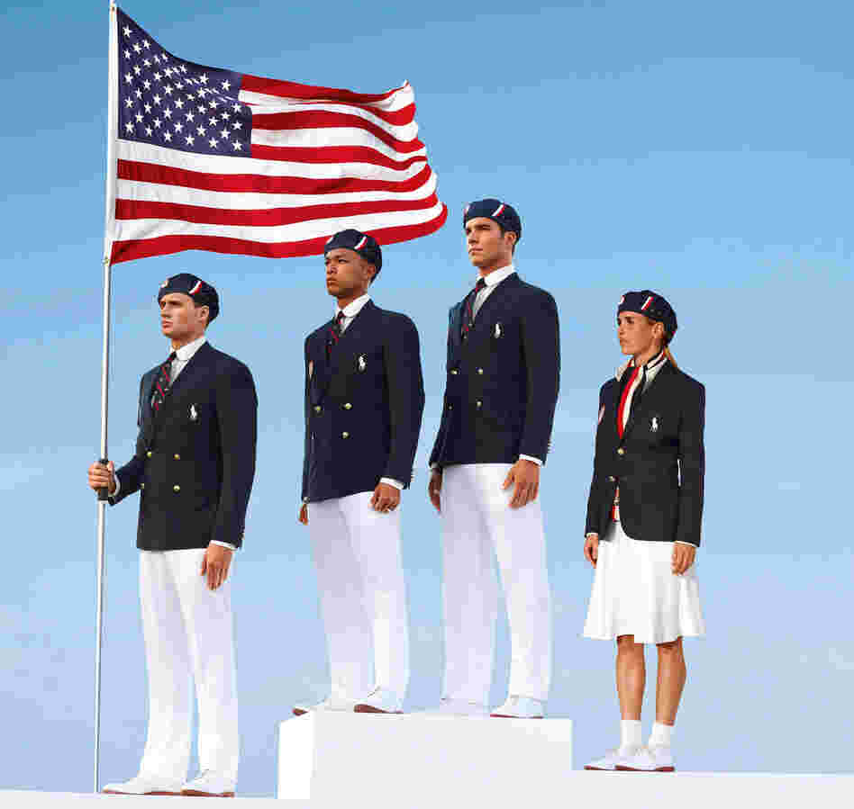 This product image released by Ralph Lauren shows U.S. Olympic athletes, from left, swimmer Ryan Lochte, decathlete Bryan Clay, rower Giuseppe Lanzone and soccer player Heather Mitts modeling the the official Team USA Opening Ceremony Parade Uniform.