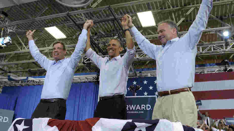 President Obama clasps hands with Sen. Mark Warner (left), D-Va., and Democratic Senate candidate Tim Kaine during a campaign stop Friday in Virginia Beach, Va.