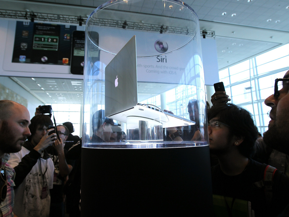 Attendees of Apple's 2012 World Wide Developers Conference look at the new MacBook Pro with Retina display.