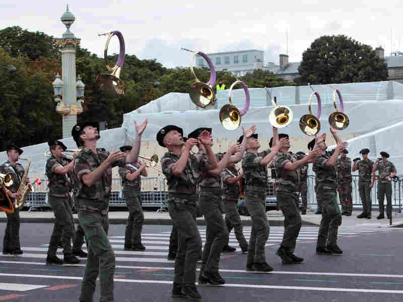 A French military brass band parades on the Champs-Elysee during a rehearsal as part of the Bastille Day celebrations, which take place Saturday.