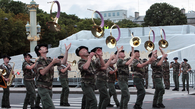 A French military brass band parades on the Champs-Elysee during a rehearsal as part of the Bastille Day celebrations, which take place Saturday. (AFP/Getty Images)