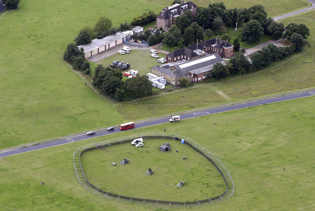 A British military missile battery, part of the Olympic security plan, is seen from an aircraft in south London. Organizers have been criticized for relying on a military presence for the 2012 Games.