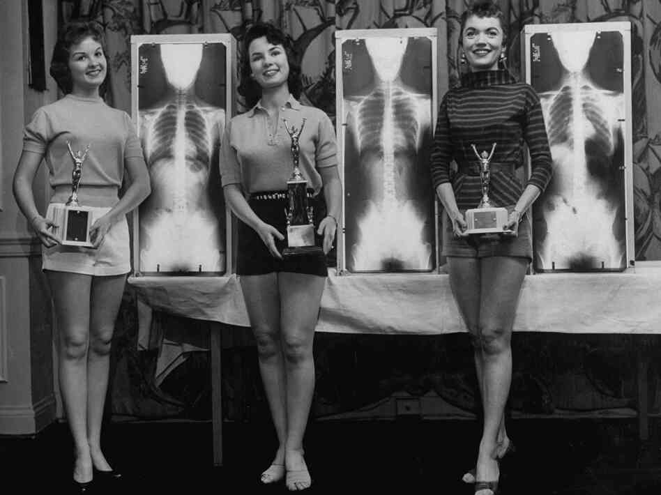 Contestants (from left) Marianne Baba, Lois Conway and Ruth Swenson pose with trophies a