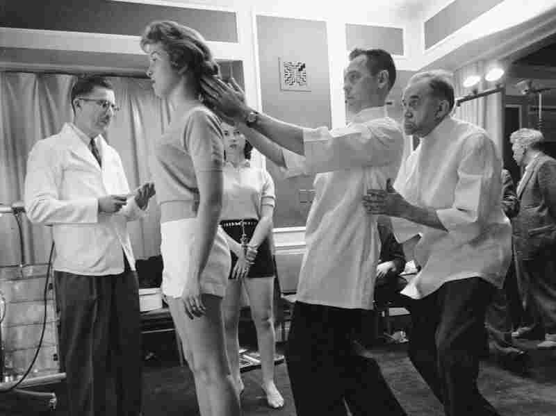 Chiropractors check the posture of Marianne Baba.