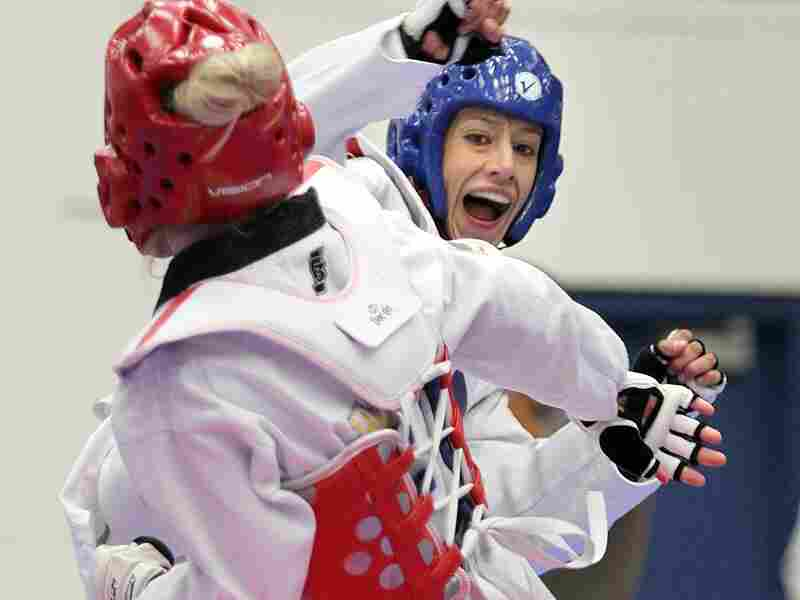 Olympian Diana Lopez (in blue) — not to be confused with the author Diana Lopez — competes in the 2012 Taekwondo Olympic Trials.