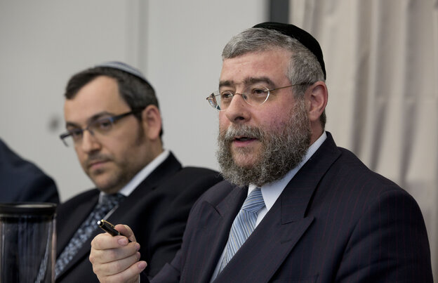 Rabbi Pinchas Goldschmidt, right, president of the Conference of European Rabbis, gestures next to Rabbi Avichai Appel, left, a board member of the Orthodox Rabbinical Conference of Germany, during a news conference in Berlin, Germany on Thursday.