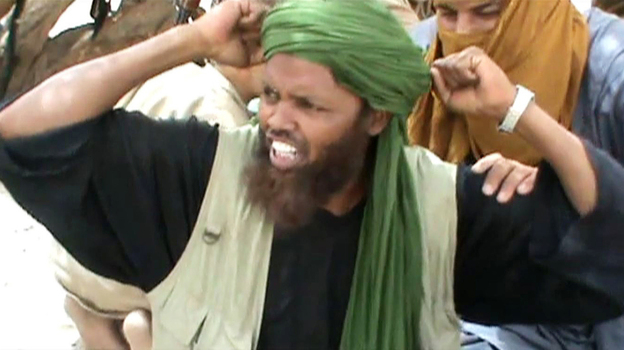 In this image from a video, an Islamist militant celebrates after the destruction of a Sufi shrine earlier this month in Timbuktu. (AFP/Getty Images)