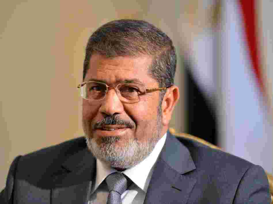 Egyptian President Mohamed Morsi looks on as he meets with American deputy secretary of State William Burns (not seen) in Cairo on July 8.