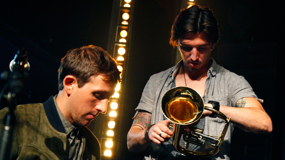 Guitar tech Shane Timm (right) and fun.'s keyboard player Andrew Dost on stage in Brooklyn. (NPR)