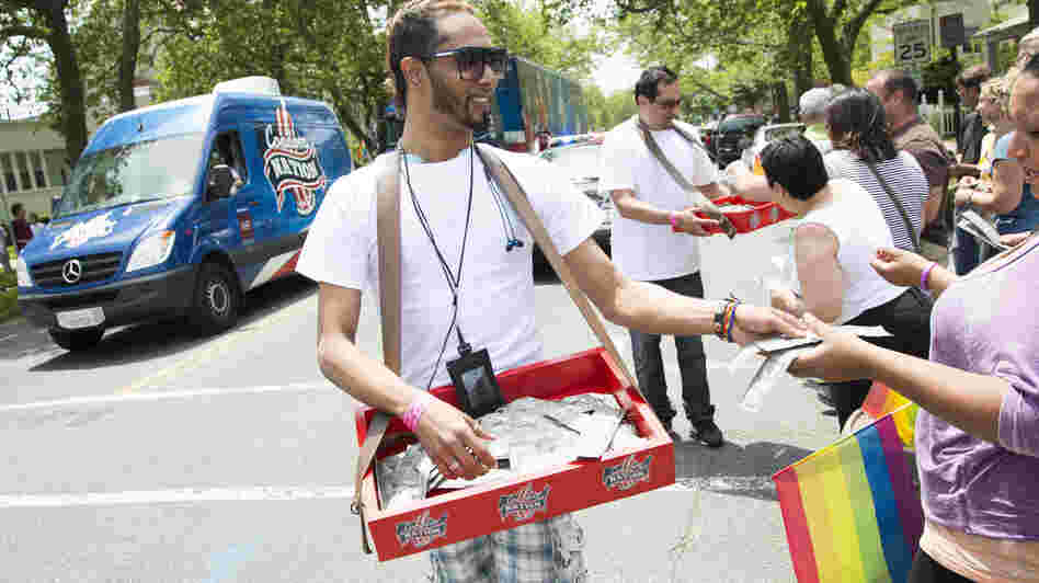 Young activists distribute condoms at an AIDS awareness event in Ashbury Park, N.J.