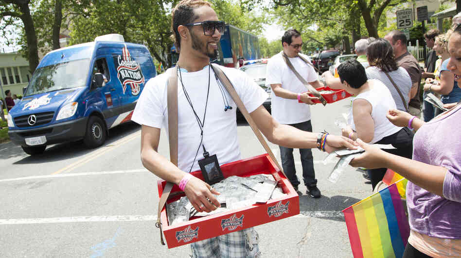 Young activists distribute condoms at an AIDS awarene