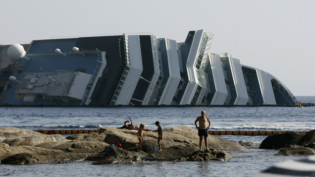 Work has begun to remove the tons of rocky reef embedded into the Concordia cruise ship's hull, off Giglio Island in Italy. The plan is to eventually tow the wreck away from the island in one piece. (AP)