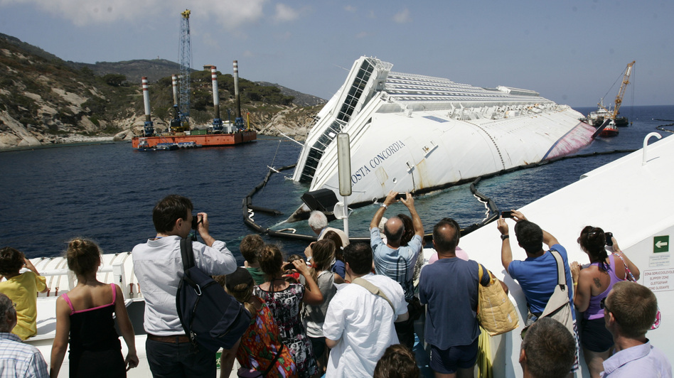 Giglio Island's nature-loving tourists have been replaced by day-trippers who want a look at the massive wreck of the Costa Concordia. (AP)