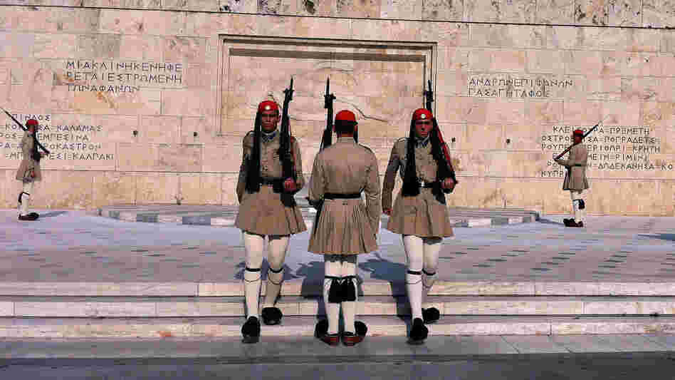 Evzones, the Greek honor guard, watch over Syntagma Square in Athens, the site of numerous anti-austerity protests in the last two years.