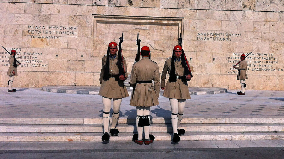 Evzones, the Greek honor guard, watch over Syntagma Square in Athens, the site of numerous anti-austerity protests in the last two years. (NPR)