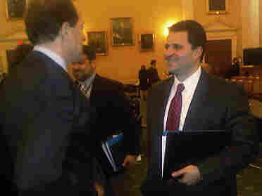 Joe Olivo (right) talks to Dave Camp (left), Chairman of House Ways and Means Committee, after testifying before the House in Jan. 2010.