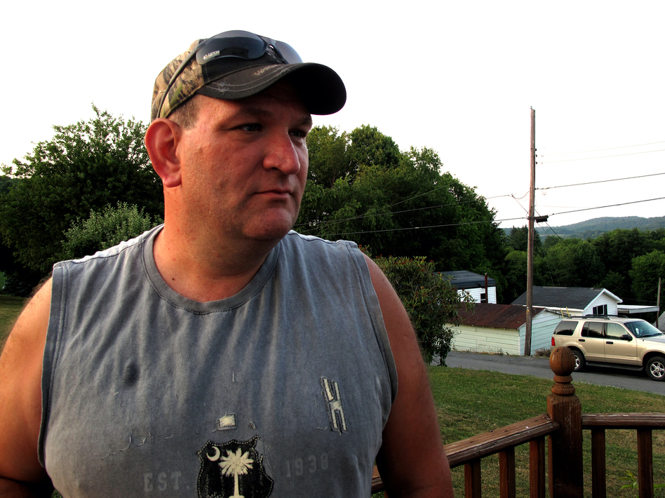 Rich Lewis worked as a miner for almost two decades before being laid off by Arch Coal. He says he's considering taking a job at another mine, but it's not certain that mine will stay open. (Michael Tomsic/NPR)