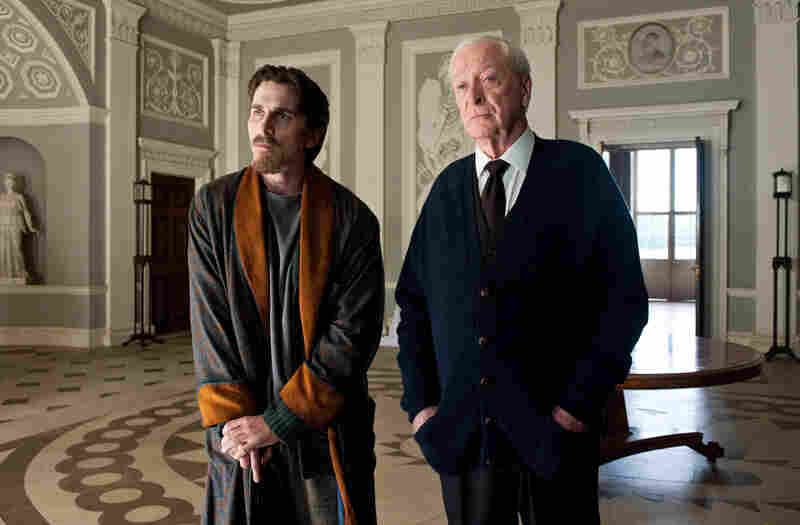 Christian Bale as Bruce Wayne and Michael Caine as Alfred in The Dark Knight Rises.