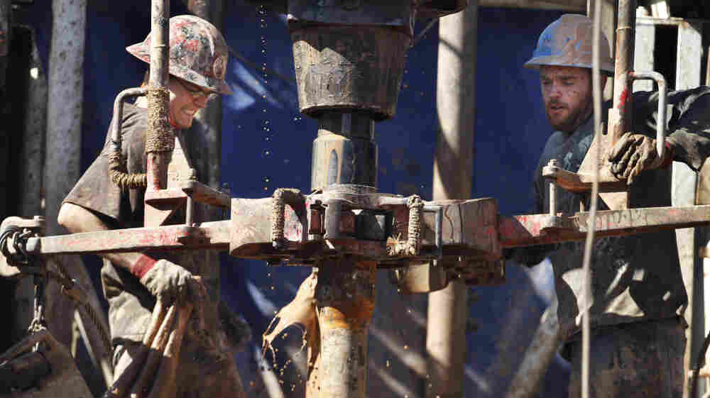 "Oil field workers drill into the Gypsum Hills near Medicine Lodge, Kan. Hydraulic fracturing, or ""fracking,"" to coax out oil and gas has led to a natural gas boom, but some remain concerned of the potential environmental impact."