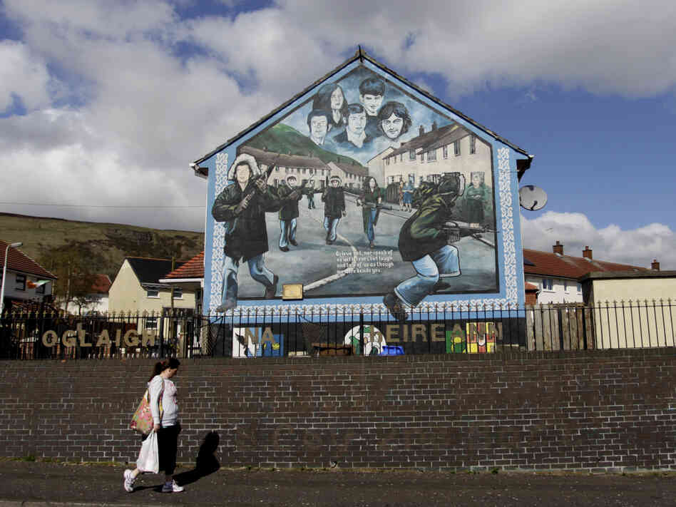 Irish Republican Army murals still loom over streets in West Belfast, where Jean McConville lived until she disappeared in 1972.