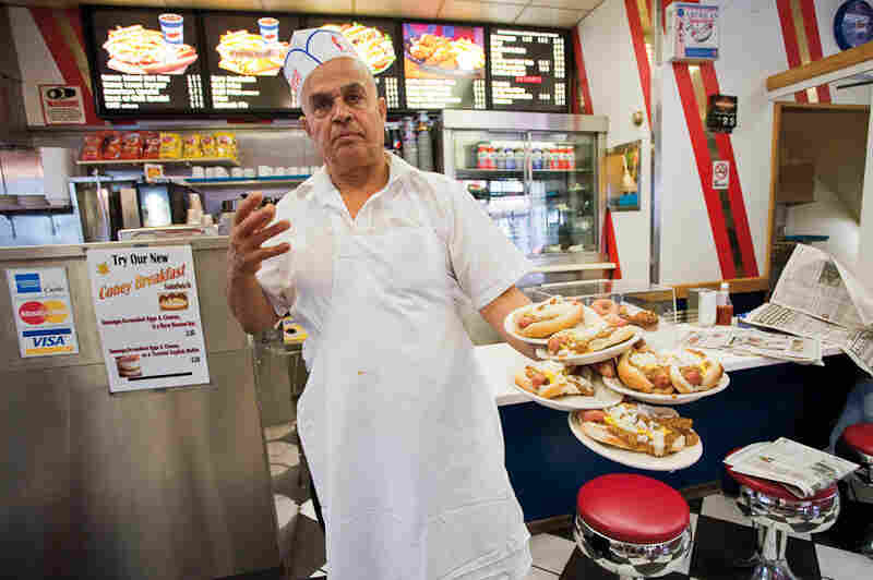 Jerry Abu El Hawa serves up hot dogs at American Coney Island, one of Detroit's most storied Coney joints.