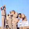 Five Air Force officers stand at ground zero of an atomic bomb test at a Nevada test site on July 19, 1957.