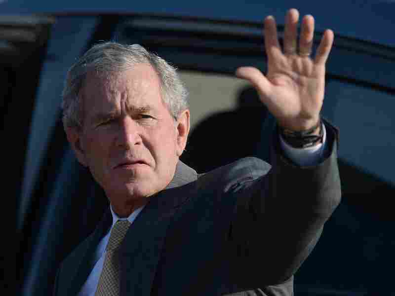 Former President George W. Bush salutes upon arrival at the airport of Gaborone, Botswana, on July 5. Bush's landmark tax cuts are now the subject of debate between Democrats, who want to end them for the highest earners, and Republicans, who want to keep them for everyone.