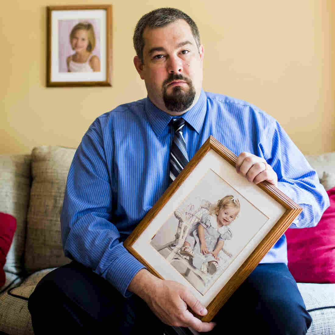 Chris Truitt holds a photo of his daughter, Alyssa, who died when she was 2, at his home in De Forest Wis. After donating her organs and tissues, he decided on a career change that made him rethink tissue donation.