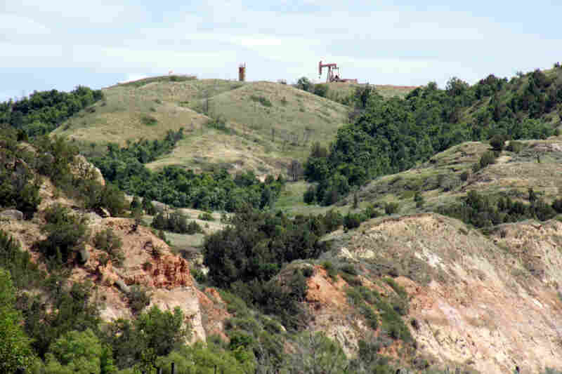Oil wells have begun to appear on the ridges above the Little Missouri Valley.