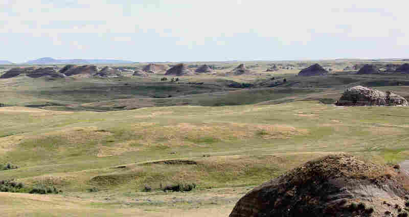 Rock formations stretch off in the distance, seen from Elkhorn Ranch.