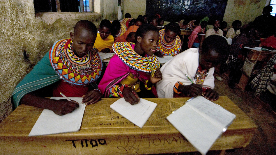 Kenya's attempt at universal education faces multiple challenges. In many rural areas, families want their kids to work during the day. At this school in central Kenya, Samburu kids who herd the family livestock are now taking classes in the evening. (AFP/Getty Images)