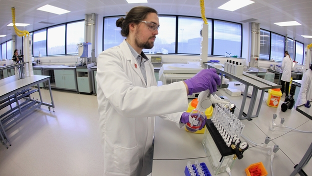An analyst works in the Olympic anti-doping laboratory in January.  The lab in Harlow, England will test 5,000 of the 10,490 athletes' samples from the London 2012 Games.