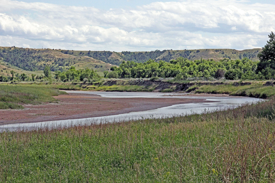 The Little Missouri River curves just in front of the Elkhorn Ranch site. The river flows north here to join the Missouri River. (John McChesney for NPR)