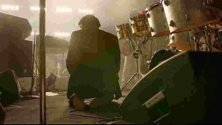 James Murphy, frontman for the now-disbanded LCD Soundsystem, kneels on the Madison Square Garden stage. Shut Up and Play the Hits documents the band's final show at the landmark New York venue.