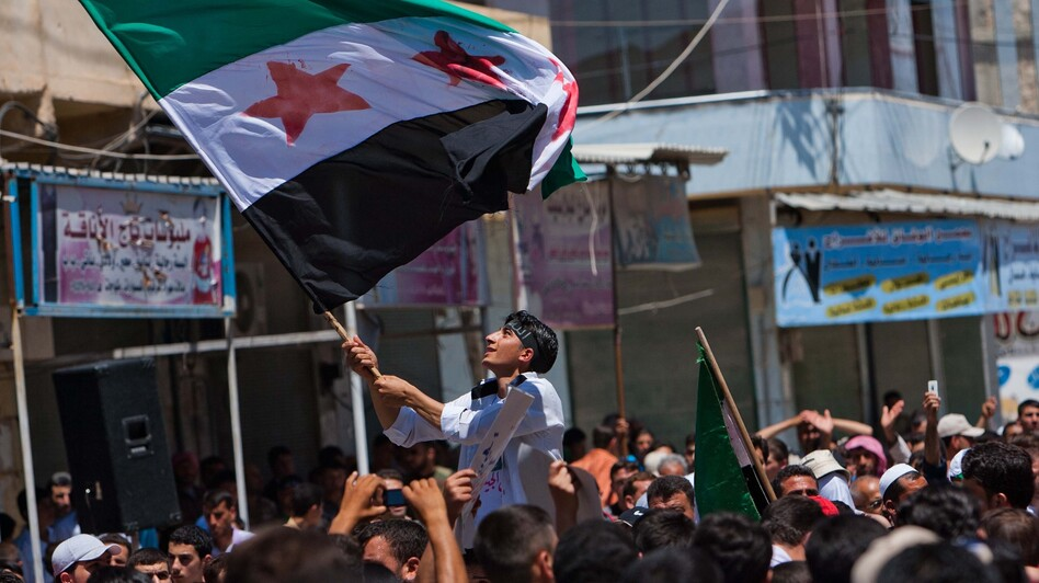 Syria's ongoing fighting is increasingly a sectarian conflict with the majority Sunni Muslims facing off against the Alawites who make up most of the country's ruling elite. Here, government opponents rally in the northern town of Mareh on June 29. (AFP/Getty Images)
