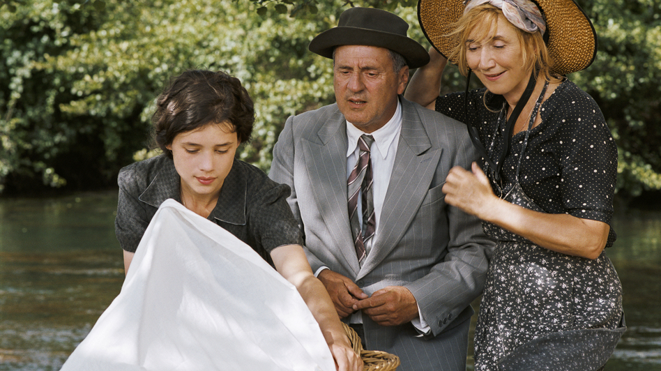 Pascale (Daniel Auteuil) with his sister Nathalie (Marie-Anne Chazel, right) and daughter Patricia (Astrid Berges-Frisbey), who, to his dismay, becomes pregnant in The Well-Digger's Daughter. The film is a remake of Marcel Pagnol's 1940 movie. (Kino Lorber)