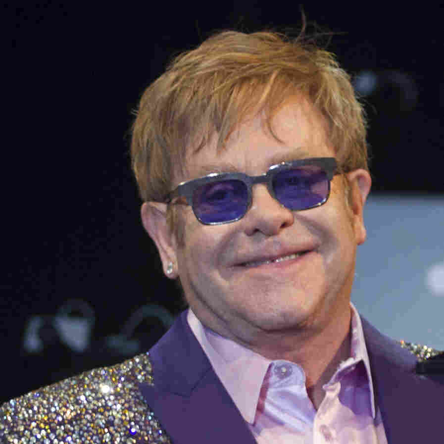 Elton John performs in Ibiza earlier this month. The British singer's new memoir is titled Love Is the Cure.