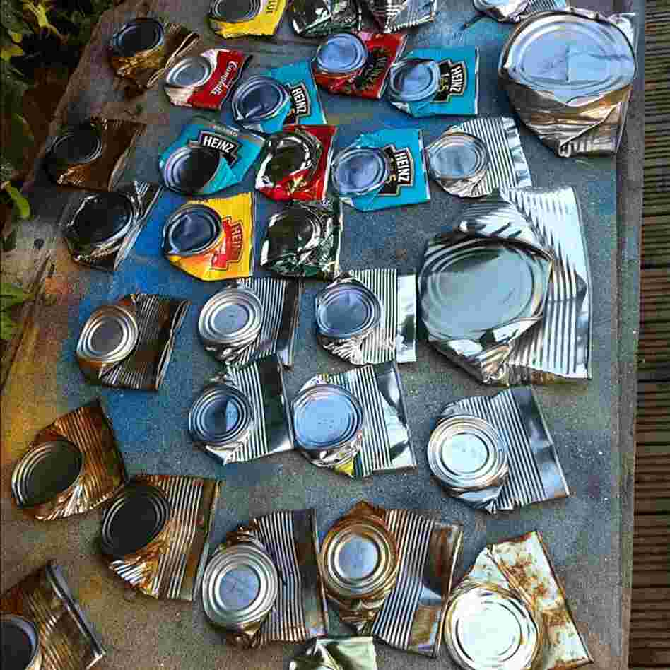 Collection of can bodies, awaiting face painting.