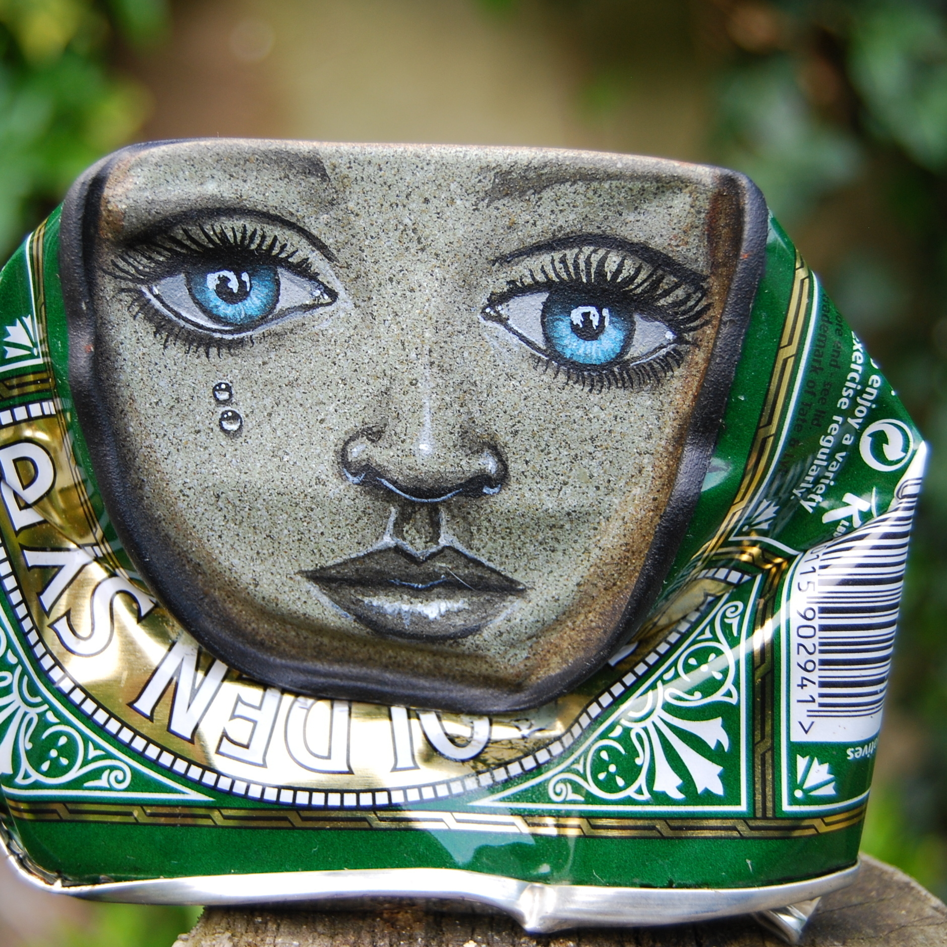 Face painted on a Lyle's Golden Syrup can.