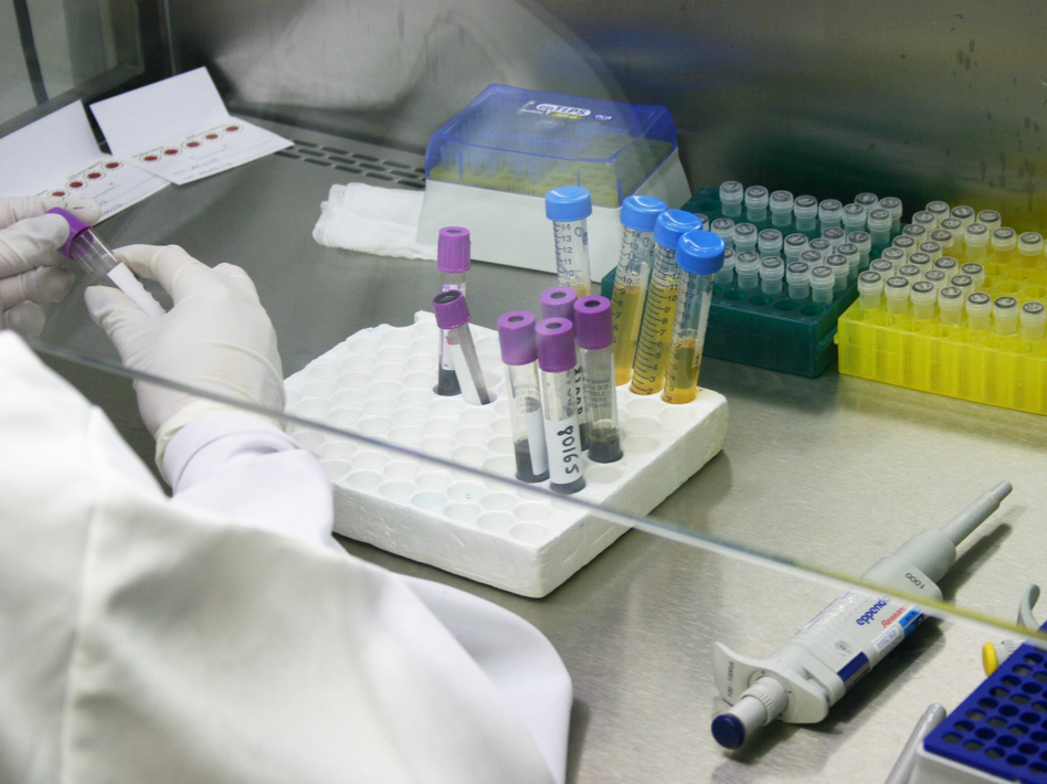 Researchers with HIV medication at a public research lab at the Oswaldo Cruz Foundation, or Fiocruz, in Rio de Janeiro.