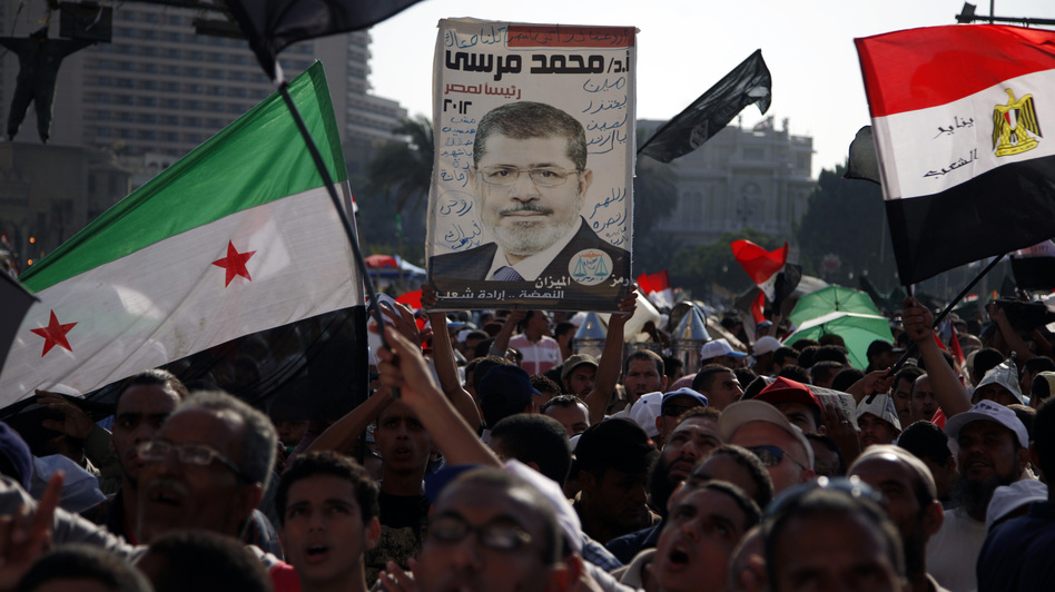 Demonstrators chant slogans supporting Egyptian President Mohammed Morsi during a rally in Tahrir Square in Cairo on Friday. (AP)